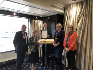 Ald Alison Gowman and Immediate Past President Paul Herbage present the Master Poulter, Court Assistant Liz Garner, and Clerk Julie Pearce with the Award.Poulter & Liz Garner